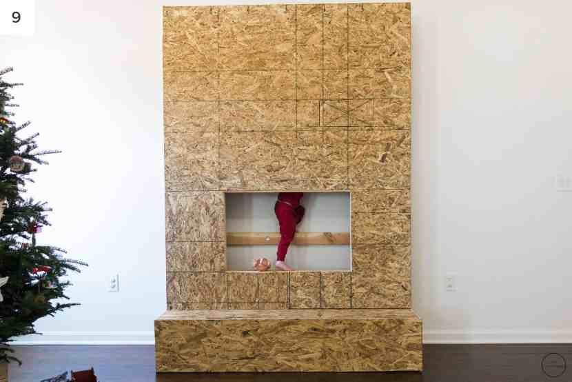 the modern farmhouse electric fireplace surround and hearth is encased in plywood