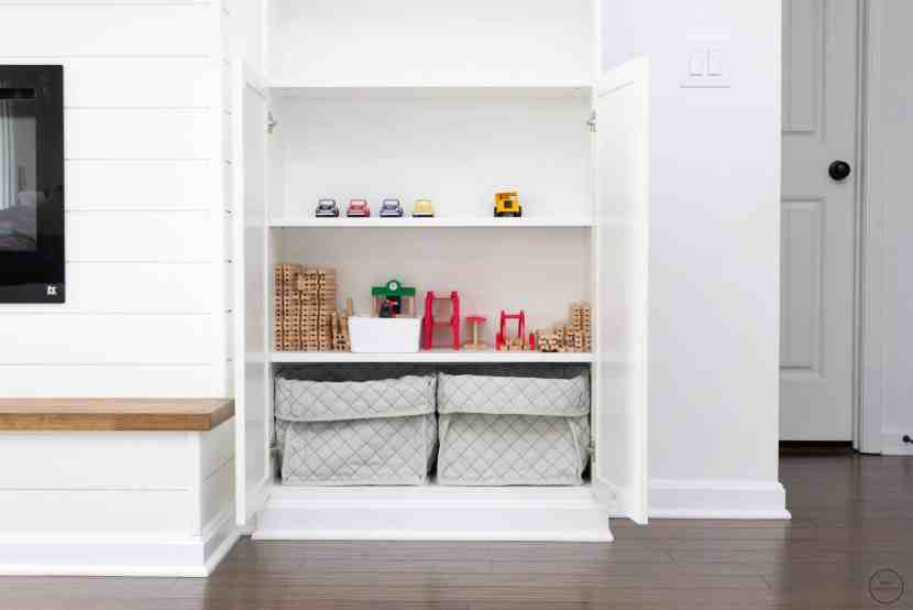 IKEA baskets are used to store open-ended toys in a Billy bookcase with Oxberg doors