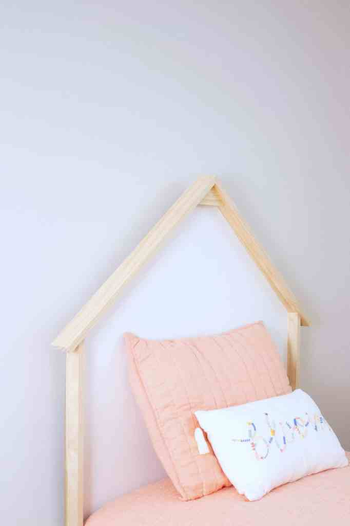 Learn how to build a budget-friendly twin size house headboard for kids. View the complete tutorial at www.freeandunfettered.com. #designingwithkids #modernhome #homedecor #kidsroom #sharedbedroom #diyheadboard