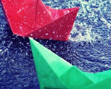 Colored Paper Boats In The Rain
