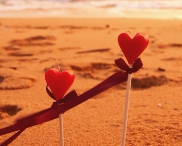 Heart Shaped Candles On The Beach