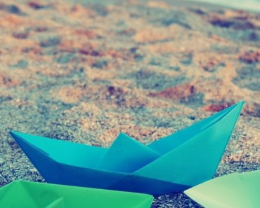 Colored Paper Boats On The Beach