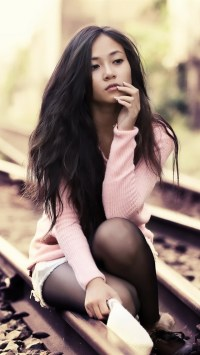 Lonely Girl Sitting On The Tracks