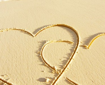 Linked Hearts On Beach