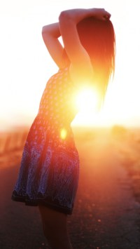 Girl Silhouetted In The Sunset