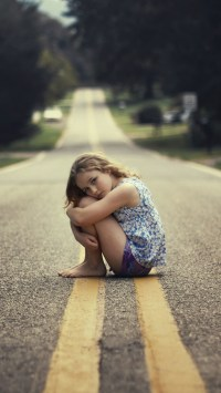 Little Girl Sitting On The Road