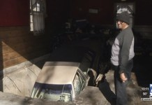 Car Falls Through Garage Floor Of Kansas City Home