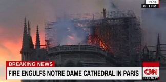 People Sing Hyms As Fire Consumes The Notre Dame Cathedral