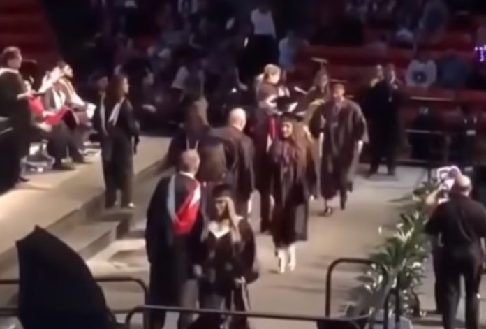 Idiot Kid Tries (And Fails) Graduation Backflip