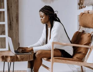 black lady looking at laptop
