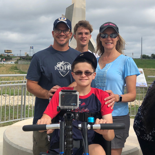 The Pivirotto family poses for a photo after receiving their adaptive bicycle.