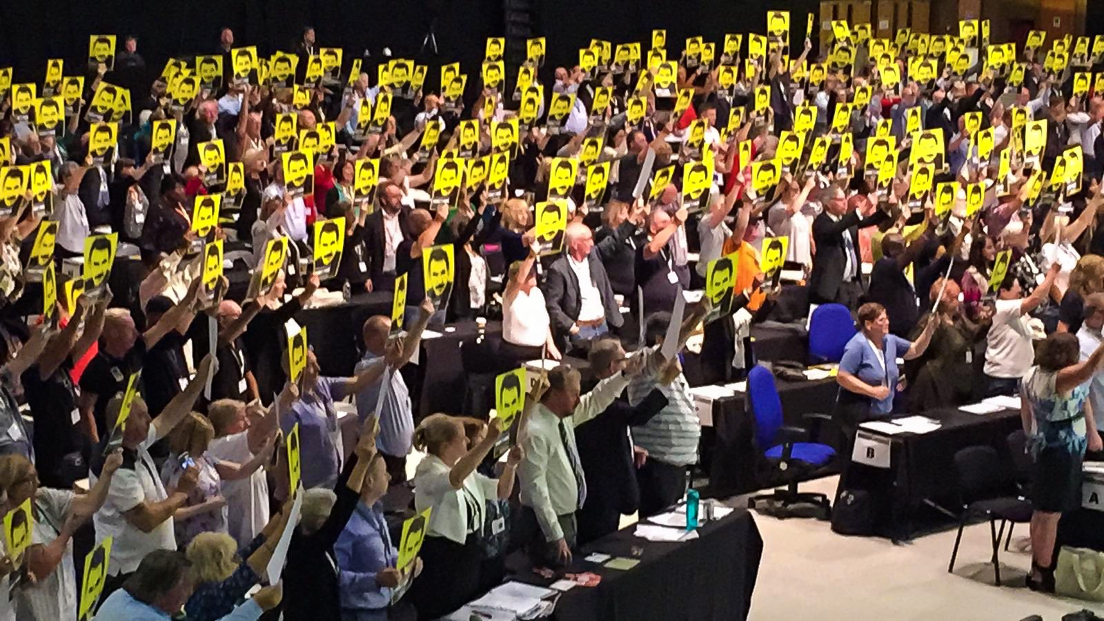 a wide shot of delegates holding Freedom for Ocalan placards at TUC 2019