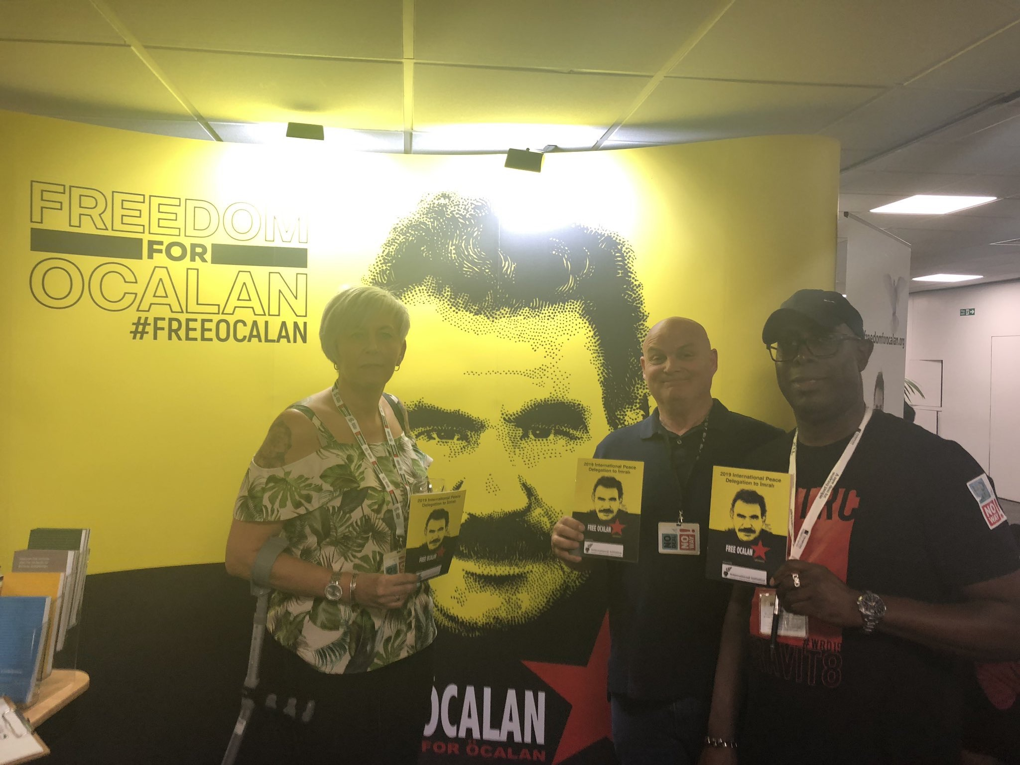 Paula Brenn, Tom Murphy London Print Branch, Unite GPM & IT Sector and Executive Council GPM & IT, Unite the Union, James Mitchell Executive Council member Unite the Union holding placards calling for Freedom for Ocalan at TUC Congress 2019