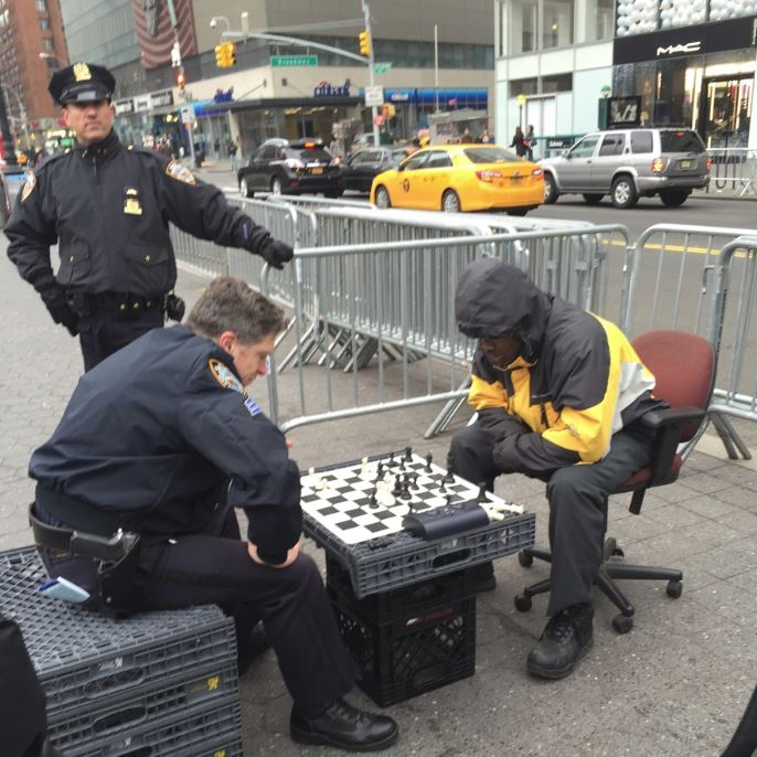 14-12-cop-beat-black-man-street-chess