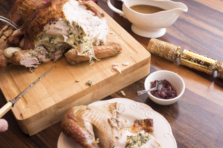 Serving carved roast Christmas turkey - Free Stock Image
