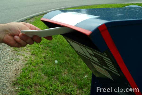 Dropping a letter into a US Mail Box