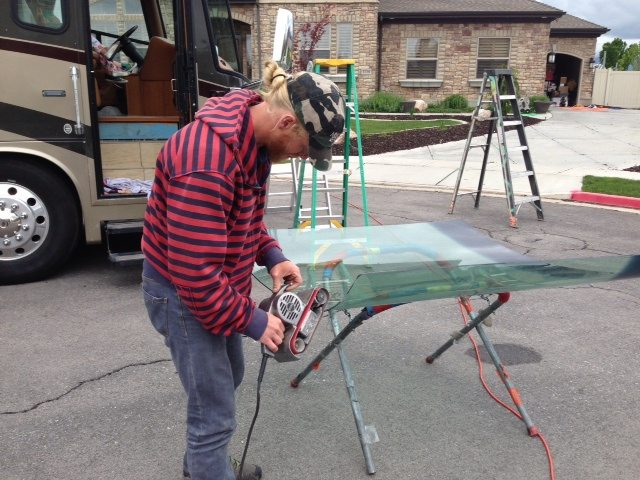 Precision Glass Technician working on RV windshield