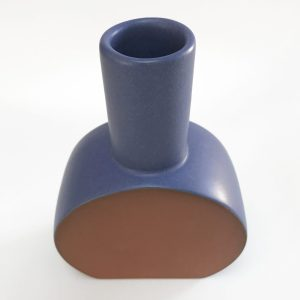 matte blue vase, round base, slender neck, unglazed face