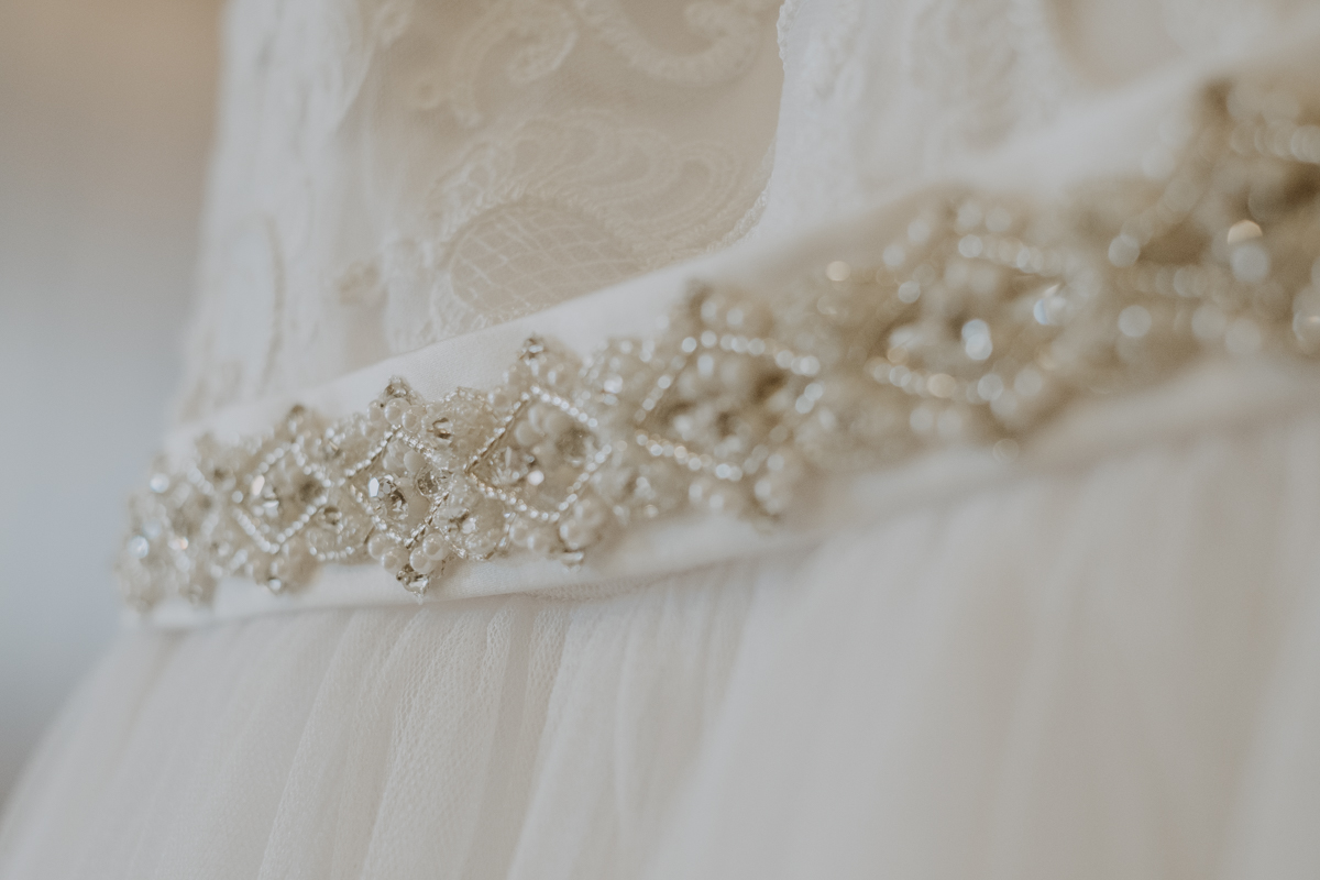 beaded wedding dress details | Emily + Aaron | Freehearted Film Co | Tampa Wedding Photography and Wedding Videography