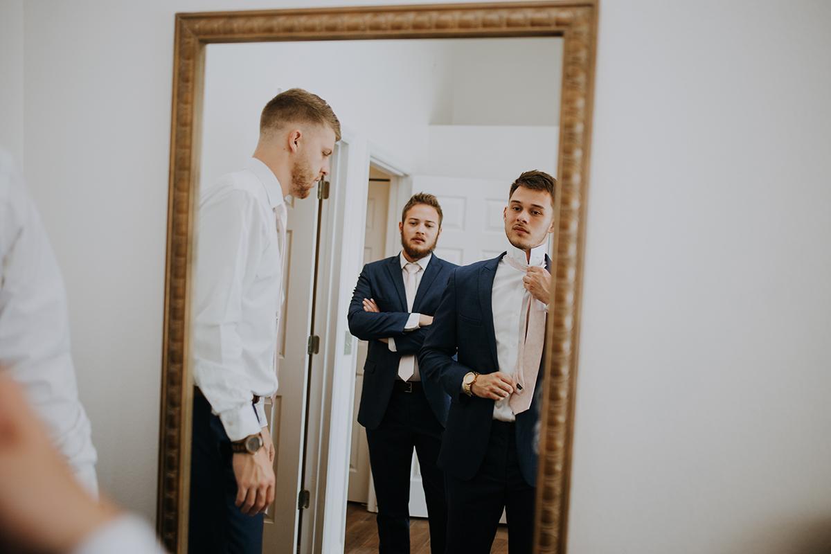 groom getting ready | straightening the tie | Florida wedding photographer