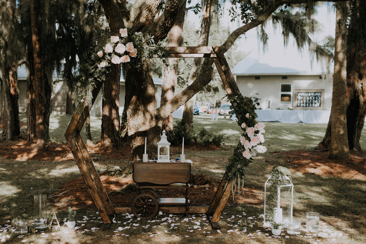 octagon wedding arch | geometric arch | floral arch | outdoor Florida wedding | romantic sarasota wedding photographer | romantic sarasota wedding | tampa wedding photographer | freehearted film co