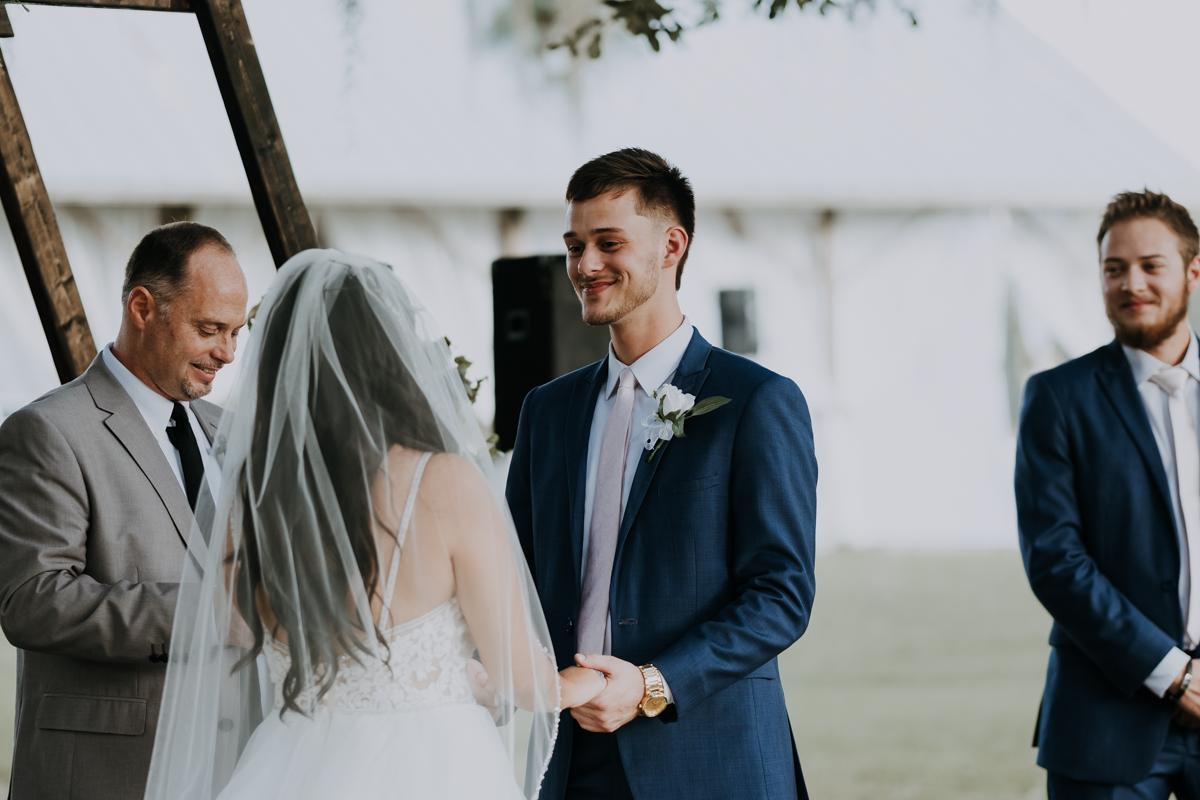 bride and groom at the altar | boho wedding | romantic sarasota wedding photographer | romantic sarasota wedding | tampa wedding photographer | freehearted film co