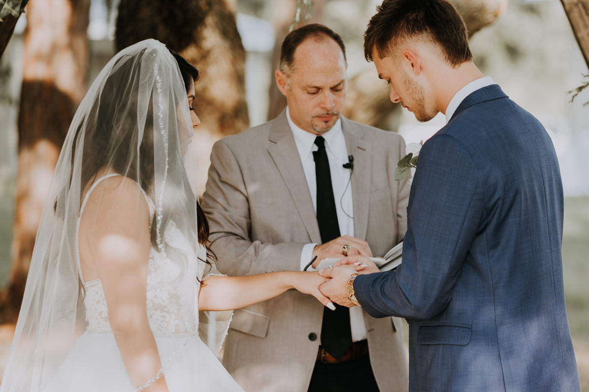 exchanging the rings | giving of rings | romantic sarasota wedding photographer | romantic sarasota wedding | tampa wedding photographer | freehearted film co