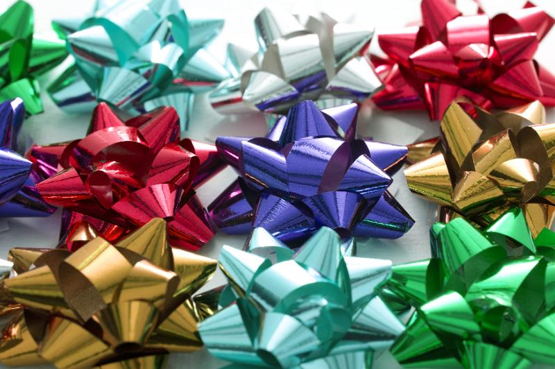 Free Stock Photo: Collection of colorful decorative bows in shiny ribbon for decorating and wrapping gifts for festive occasions