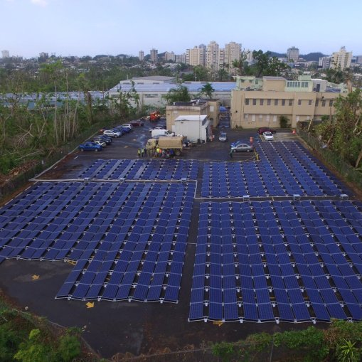 Views of the San Juan Children's Hospital and its parking lot full of Tesla's solar panels