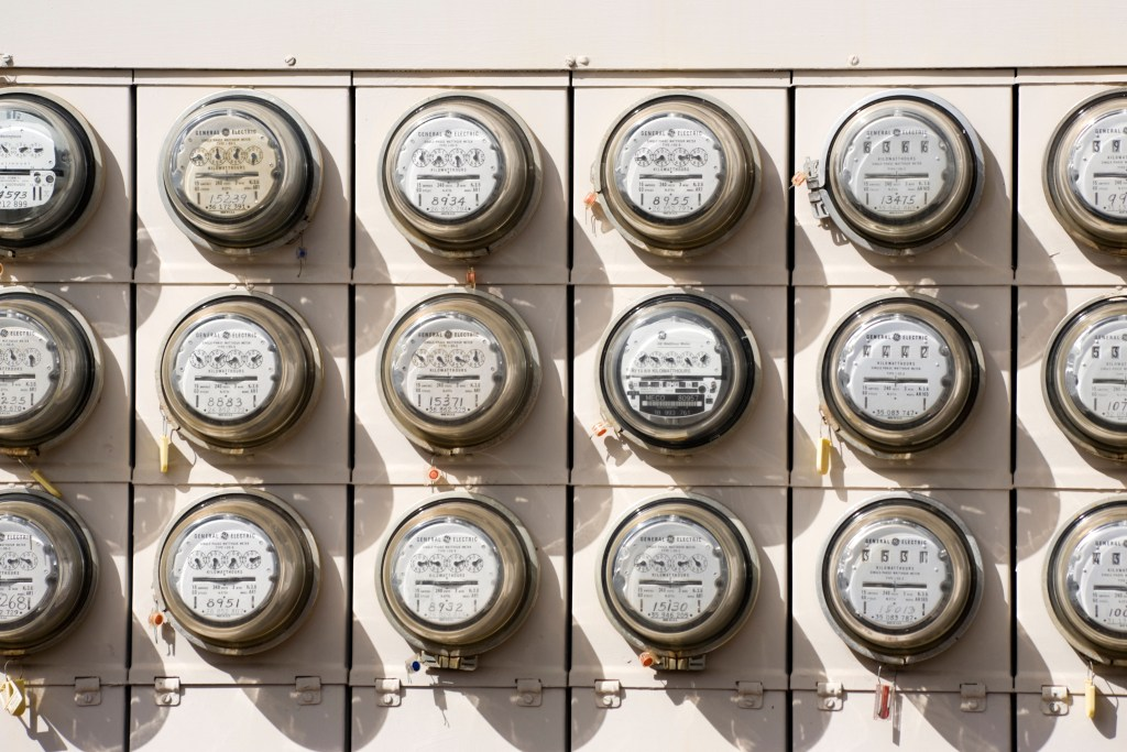 A bank of electric meters Alamy AT1J4P