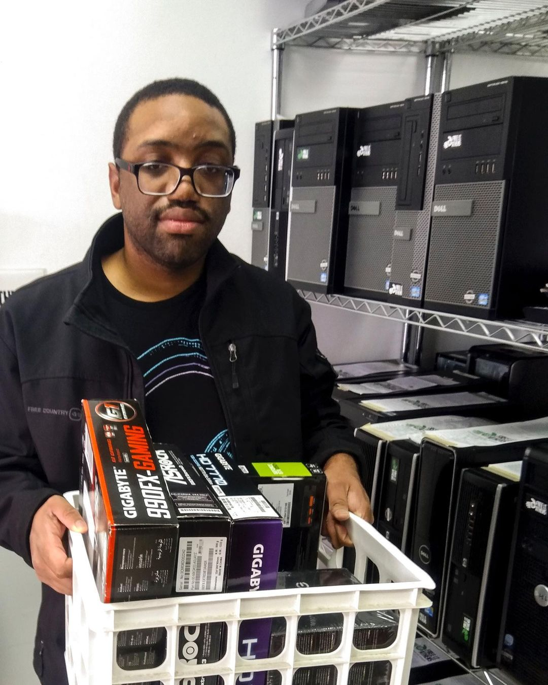 Volunteer with a bin of graphics cards