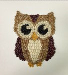 Mosaic owl made from various colors of beans