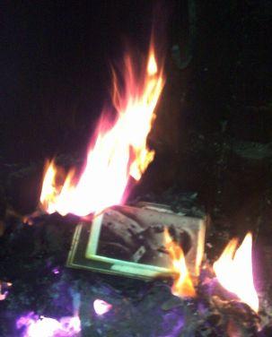 Joseph Stalin's portrait burning in a fireplace in a village in Guria, Georgia, Kober