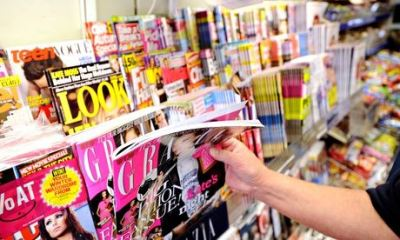 Magazines on a stand in a newsagents