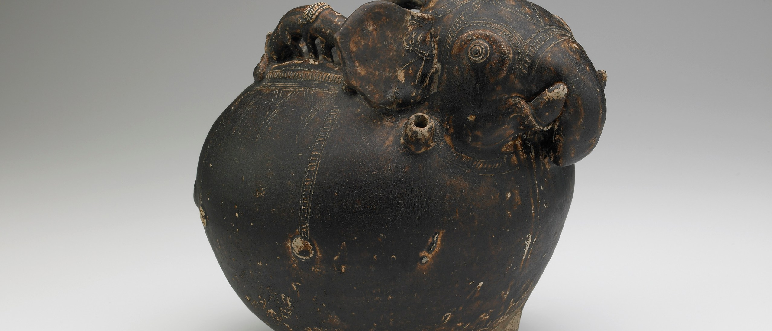 Pouring vessel in the form of a caparisoned elephant, with a spout on the shoulder