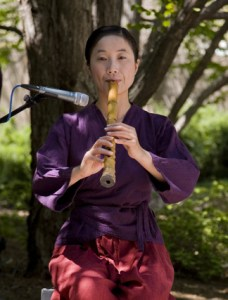 woman playing a woodwind instrument