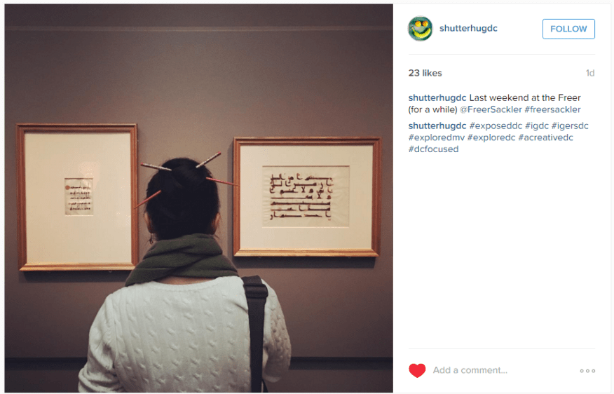 "Instagram picture of the back of a woman looking at two framed works of calligraphy. ""Last weekend at the Freer (for a while)"""