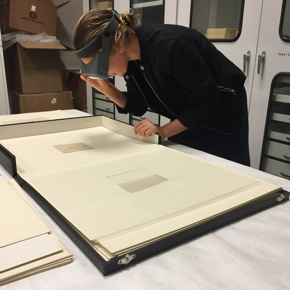 Conservator examining Whistler's drawings