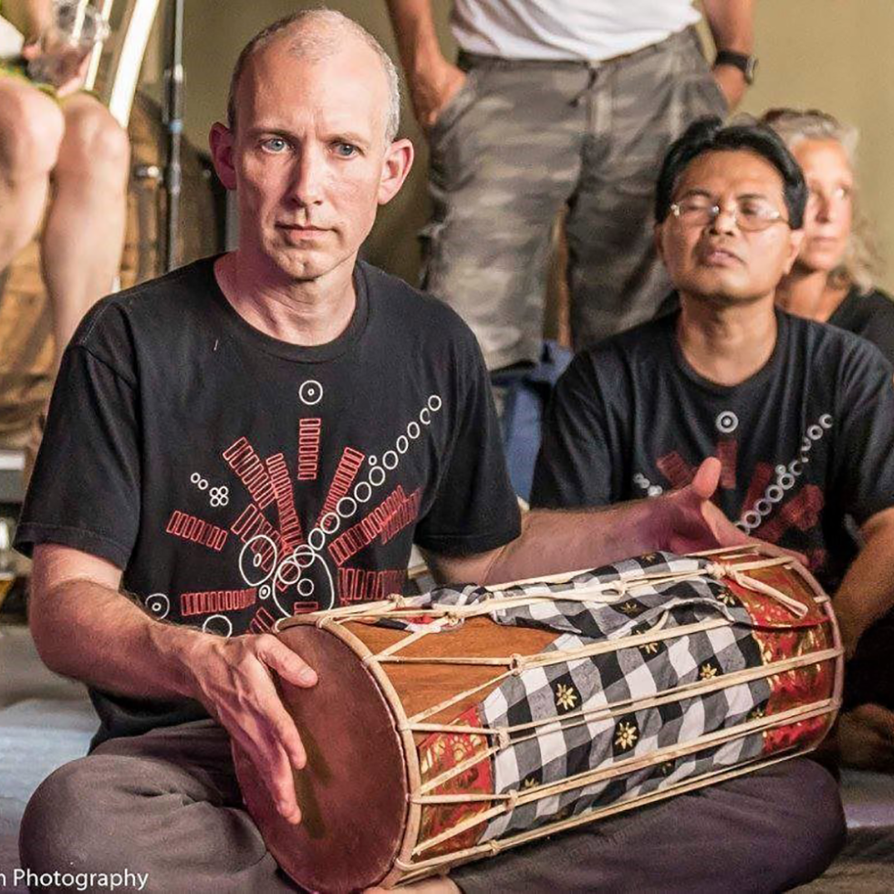 Andy McGraw plays the kendang drum with Gamelan Raga Kusuma, one of the ensembles that will perform on September 22.