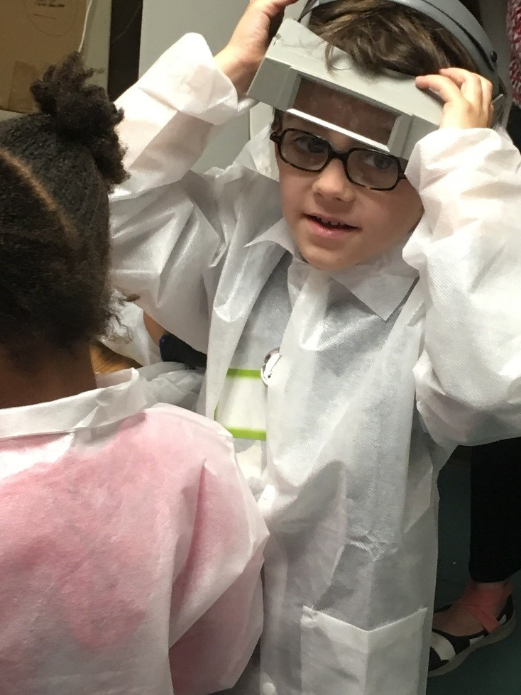 Adrian having fun trying on conservator's gear at our first workshop in May 2016.
