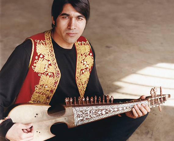 Quraishi holding a stringed instrument