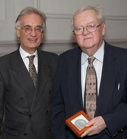 James Cahill, holding the Freer Medal, stands next to Director Julian Raby