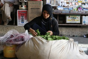 Woman selling grape leaves