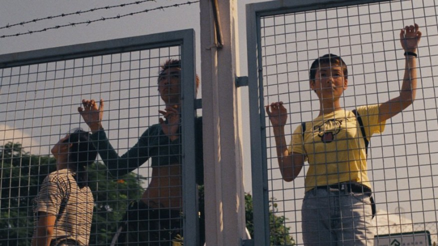 People looking through fence.