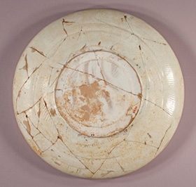 Back of dish F1953.70 after treatment