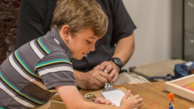 Boy creates art at an ImaginAsia workshop