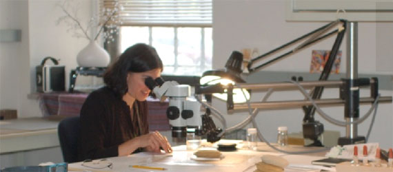 Paper & Photographs Conservator Emily Jacobson working in the laboratory.