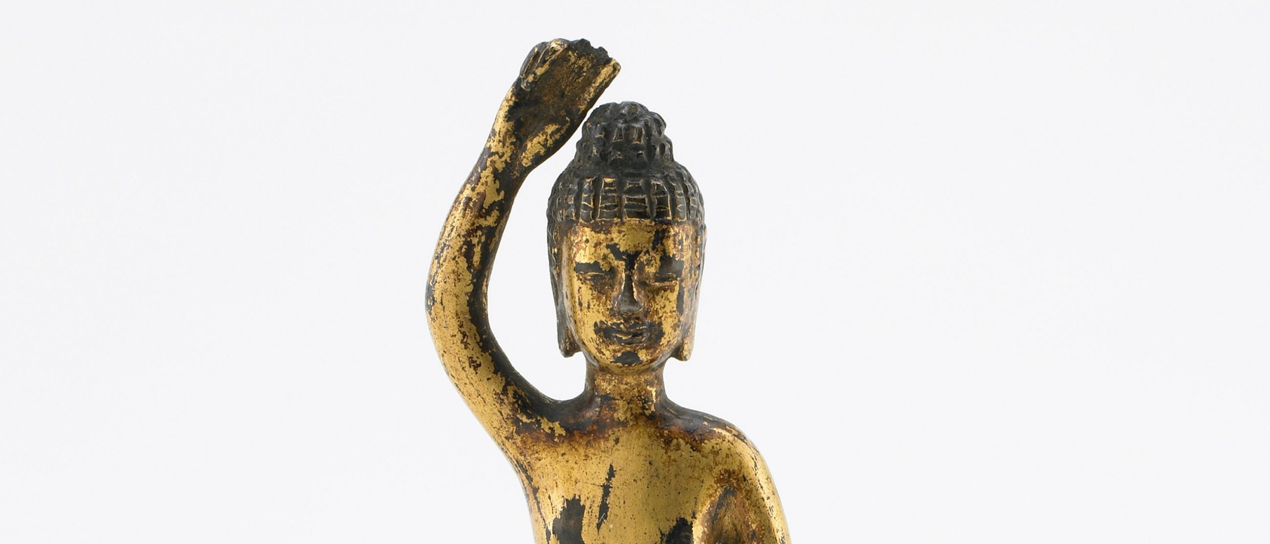 Detail (top half) of The Buddha at Birth, gilt bronze sculpture of a Buddha with his arm raised