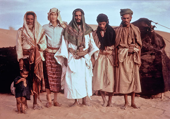 Wendell Phillips poses with expedition party in the desert.