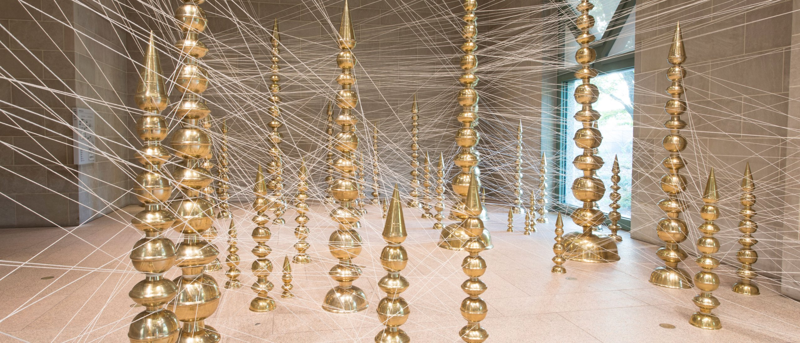 in gallery view of Subodh Gupta's terminal installed in the Sackler pavillion